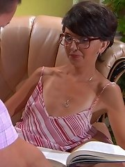 Seductive mature maid readily servicing her lusting for a fuck young master