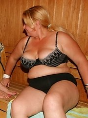 Mature ladies bathing and relaxing in a sauna