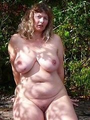 Fat mature naturists posing outdoors