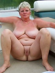 Mature nudist wives in a boats