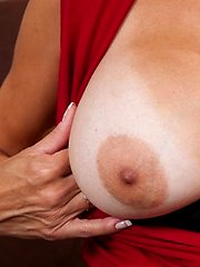 Shapely brunette milf exposes her big natural tits at Anilos
