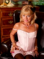 Dainty older lady gets horny after receiving a sexy phone call