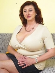 Huge breasted mature lady playing with herself
