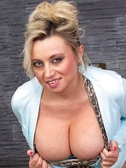 Big breasted mature woman getting ready to rock your world