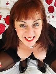 Horny British mature slut playing with herself