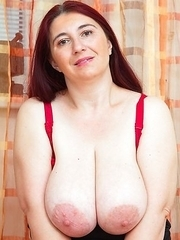 Huge breasted mature mom playing around