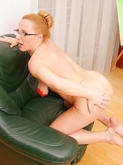 Naughty mature lady playing with paint
