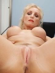 Horny MILF feeling naughty at home