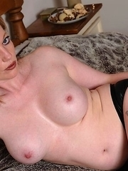 Naughty housewife sticking it in her pussy