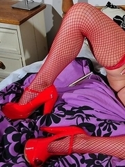 naughty housewife playing alone on her bed