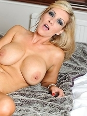 Hot MILF stuffing her pussy with a toy
